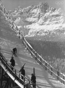 Athletes ski jump